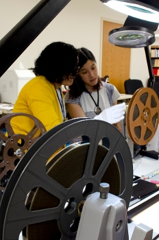 Two women working with a film reel at BAVASS