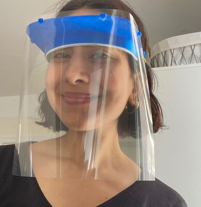 Woman wearing one of Columbia University's 3-D printed COVID virus protective face shields
