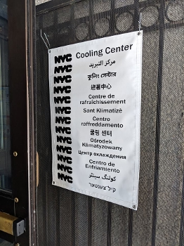sign for NYPL cooling center in various languages