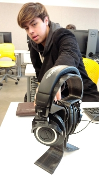 male student reaching toward headset
