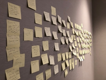 wall of post-it notes from Collective Responsibility meeting exercise
