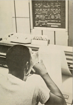 Black student seen from behind with paper