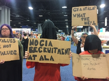 Organizers from Librarians for Democracy protesting the CIA booth at ALA