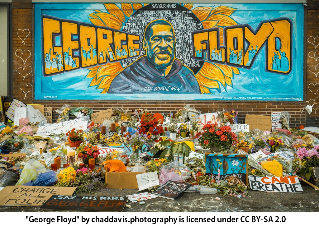 George Floyd memorial with mural painting and flowers