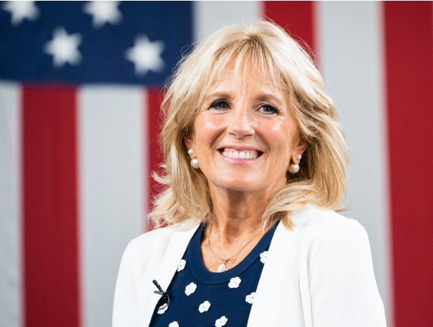 Dr. Jill Biden, headshot in front of a large American flag