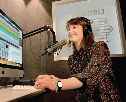 METRO's Molly Schwartz in the organization's audio recording booth