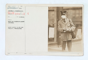 Mail carrier wearing mask during 1918 flu pandemic